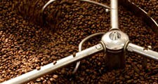 The green coffee beans are roasted to achieve the desired flavour