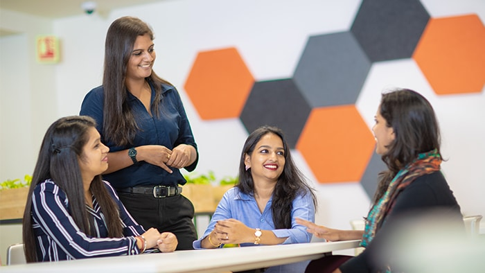 Four woman talking in the career center